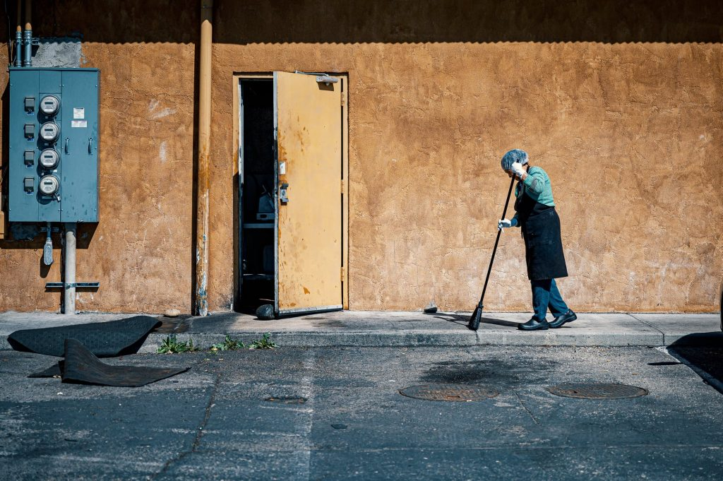 Picture of a janitor cleaning.